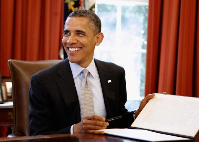Obama-smiles-after-signing-a-bill-676x485