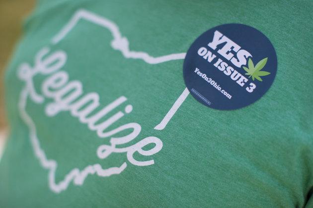 Michael McGovern, a representative from ResponsibleOhio, a pro-marijuana legalization group, wears a sticker during a promotional tour stop at Miami University, Friday, Oct. 23, 2015, in Oxford, Ohio. A ballot proposal before Ohio voters this fall would be the first in the Midwest to take marijuana use and sales from illegal to legal for both personal and medical use in a single vote. (AP Photo/John Minchillo)